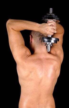 Bodybuilder training with dumbbell photo