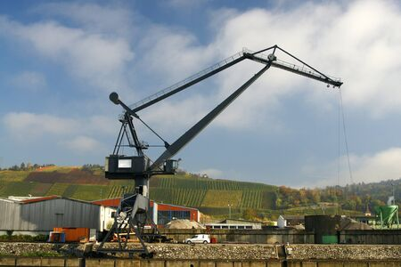 Big cargo crane at harbor with lovely colored vineyard in the background Stock Photo - 4123804