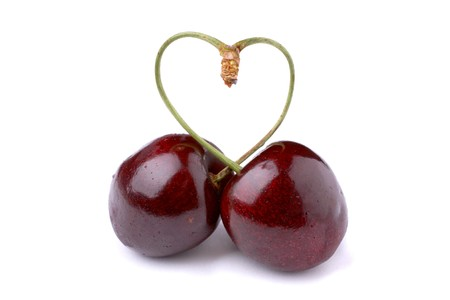 cherishing: Pair of cherries tied into a heart over white background