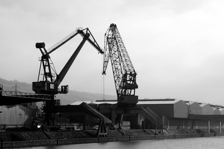 Two big cargo cranes at harbor in b&w Stock Photo - 4123838