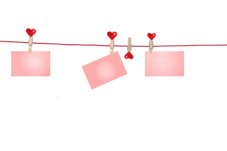 Three pink cards hanging from Clothes-Line