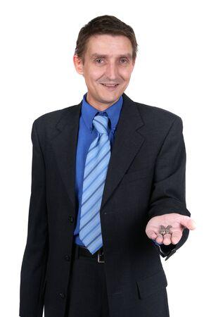 homebuyer: Businessman offering keys Stock Photo