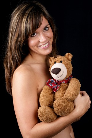 longing: Beautiful woman and teddy bear - concept for longing for a child
