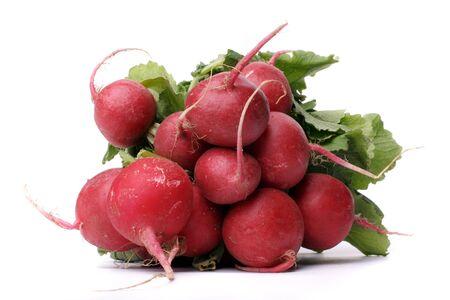 Bundle of little red radish over white background photo