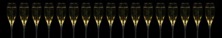 Very long banner with 17 champagner flutes in a row over black Stock Photo - 4151113