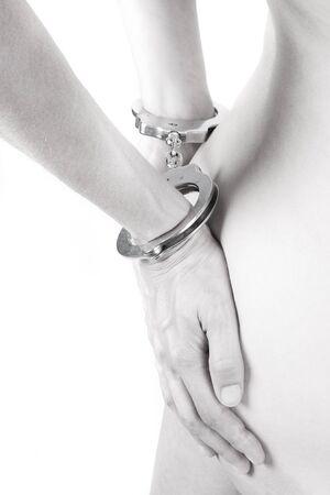 entrap: high-key of a handcuffed woman