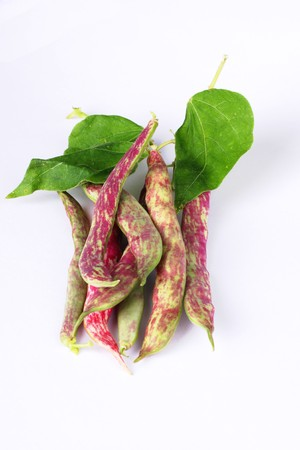 Colored beans over white photo