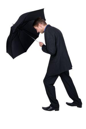 brolly: businessman holding an umbrella