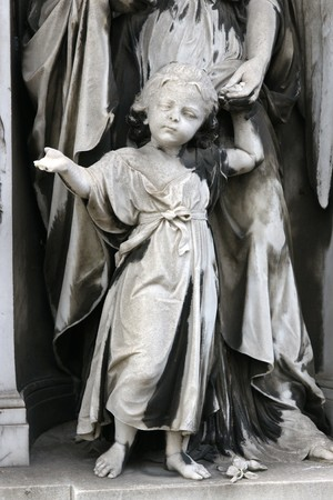 weeping angel: Ancient sculpture at a gravestone in a grave yard Stock Photo