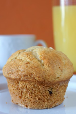 Muffin breakfast with a glass of orange juice and a cup of coffee photo