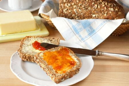 Breakfast with freshly baked homemade bread and marmalade