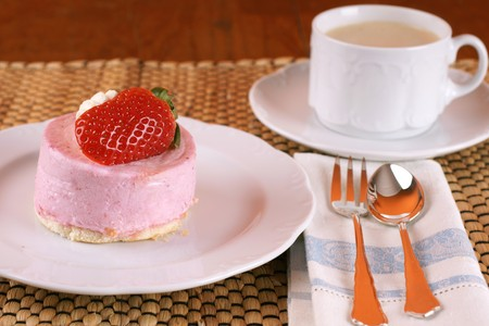 Fresh strawberry fancy cake with half a fruit on top Stock Photo - 4416851