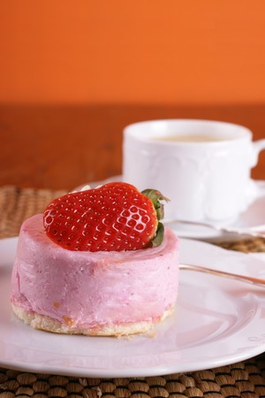 Fresh strawberry fancy cake with half a fruit on top  Stock Photo - 4416843