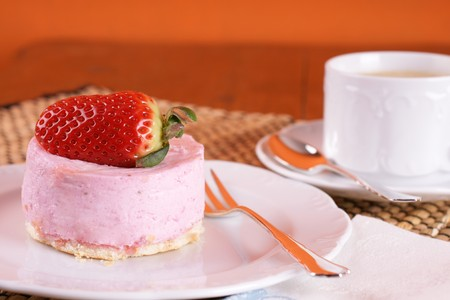Fresh strawberry fancy cake with half a fruit on top Stock Photo - 4416847
