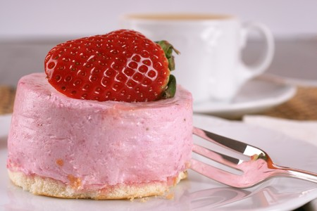 Fresh strawberry fancy cake with half a fruit on top  Stock Photo - 4416852