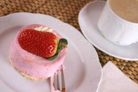 Fresh strawberry fancy cake with half a fruit on top Stock Photo - 4416838