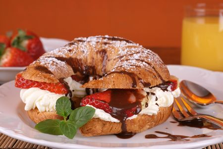French croissant with cream and strawberries Stock Photo - 4459425