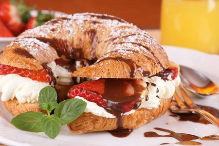 French croissant with cream and strawberries photo