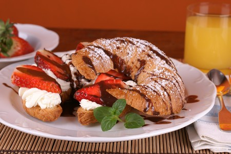 French croissant stuffed with cream and fresh strawberries Stock Photo - 4474471