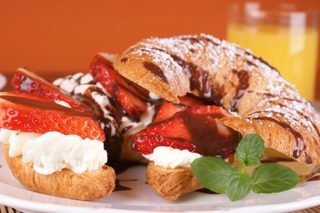 French croissant stuffed with cream and fresh strawberries Stock Photo - 4474470
