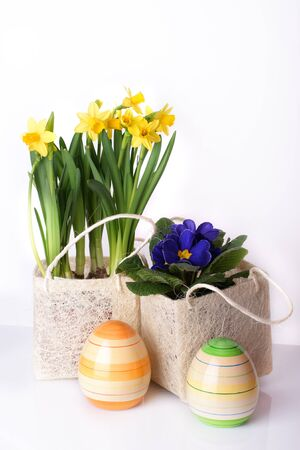 Colourful spring flower arrangement with easter eggs