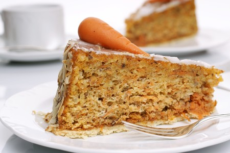Two pieces of carrot cake on white plates - bright background Reklamní fotografie