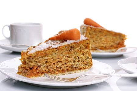 Two pieces of carrot cake on white plates