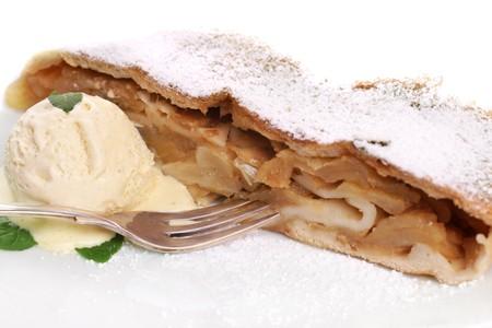 Slice of freshly baked apple strudel with vanilla ice cream