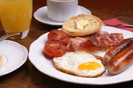 Freshly cooked breakfast with sausages and juice Stock Photo