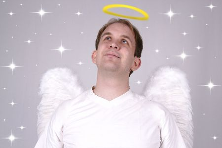 christkind: Boy with wings and halo looking like a Saint Stock Photo