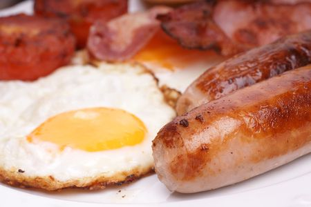 Freshly cooked breakfast with sausages and eggs photo