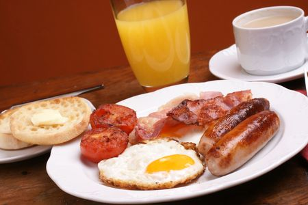 english breakfast tea: Freshly cooked breakfast with sausages and juice Stock Photo