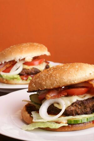Two delicious hamburger with salads and bacon photo