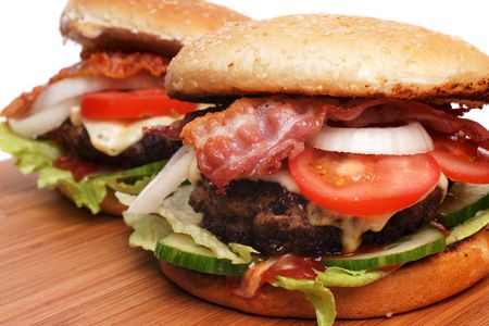 Two delicious hamburger with salads and bacon