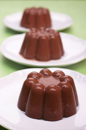 blancmange: Three homemade chocolate pudding desserts in a row. Stock Photo