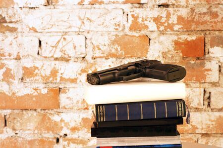 Crime Story: Handgun on top of stack of books photo