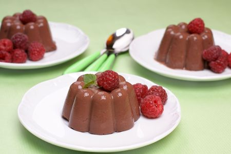 blancmange: Homemade chocolate pudding dessert and raspberries.