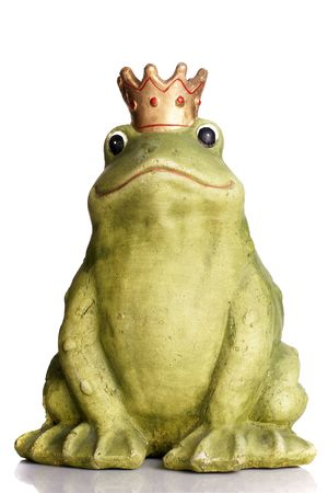 Green frog wearing a golden crown isolated over white. Stock Photo