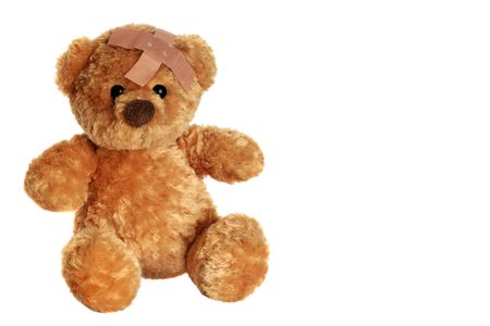 Portrait of a cute teddy bear with an adhesive bandage