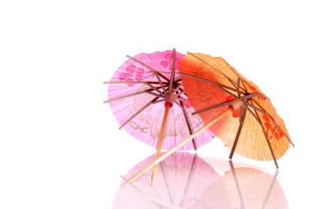 Colourful paper umbrellas forming a bright background. Stock Photo