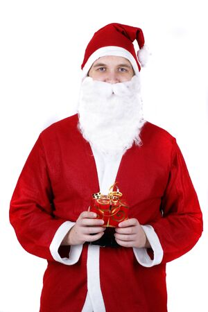 Santa Claus offering a present photo
