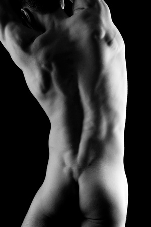 hat nude: Young muscular nude man with hat over black background