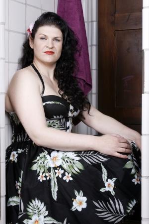 Pretty woman wearing a summer dress posing photo