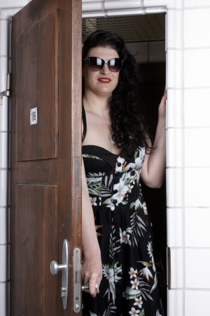 Pretty woman opening the door of a changing room photo