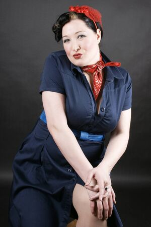 Lovely girl in rockabilly fashion posing sexy photo