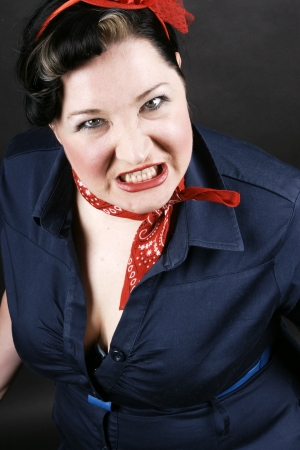 rockabilly: Portrait of an angry girl dressed in Rockabilly fashion