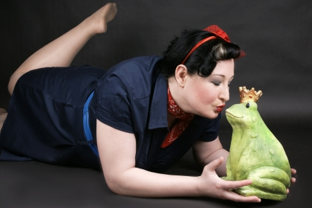 Rockabilly girl deeply in love with her frog shaped prince photo
