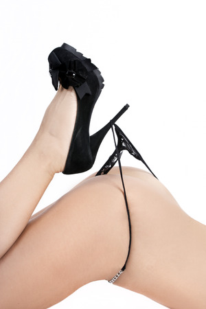 Young woman wearing black high heels and a thong photo