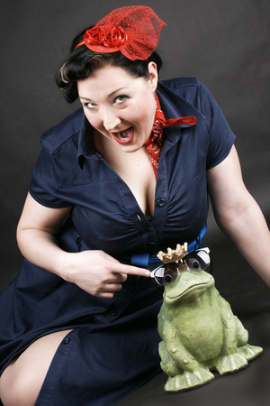 rockabilly: Rockabilly girl having fun with her frog shaped prince