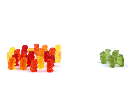 demonstrating: Different coloured gummi bears demonstrating exclusion